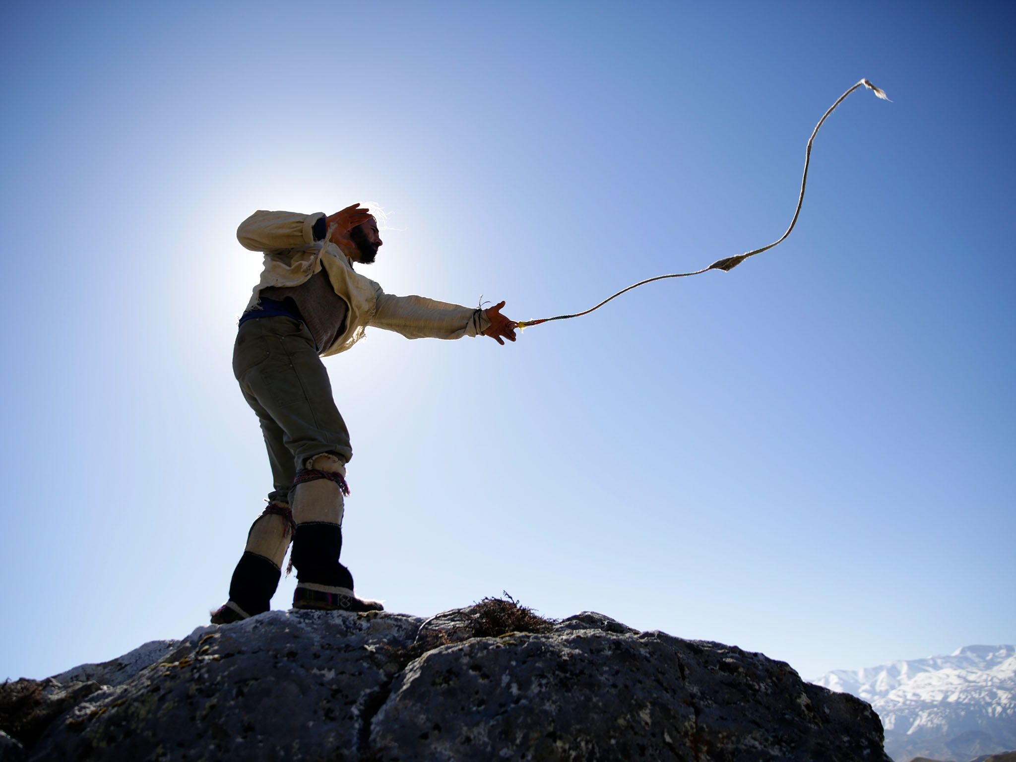 Mustang, Nepal: Hazen practicing slingshot with the sun behind him. This image is from Primal... [Photo of the day - ژانویه 2016]