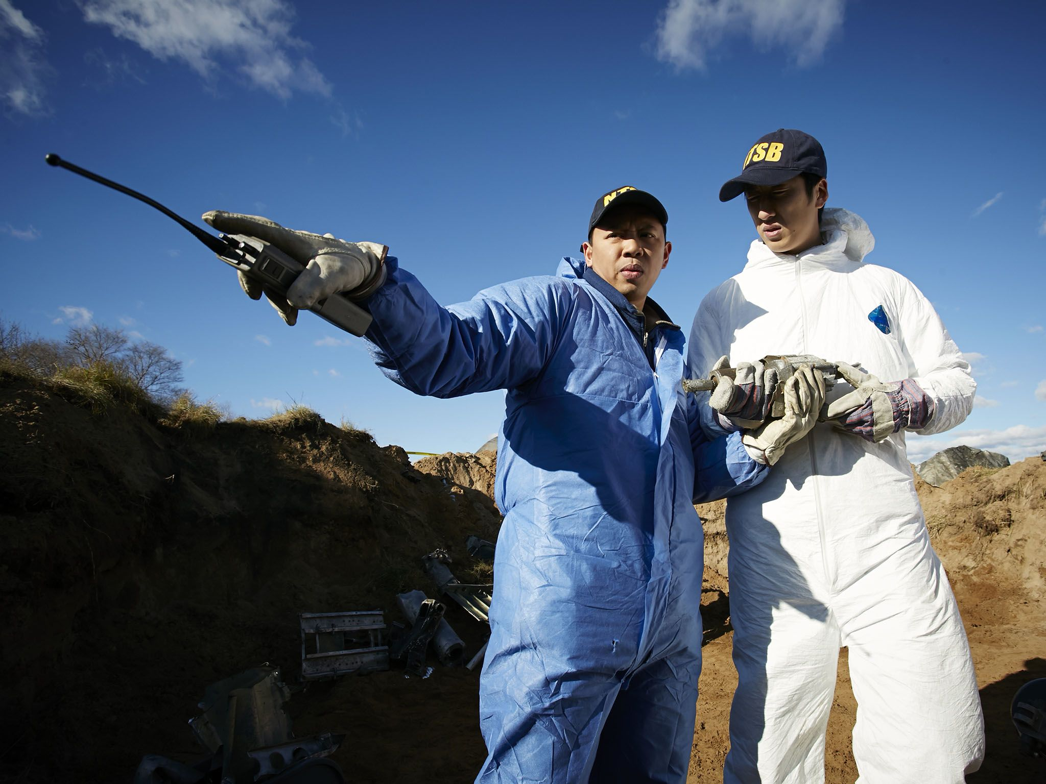 Reenactment: NTSB Investigator (played by Byron Abalos) and another investigator stand in the... [Photo of the day - می 2016]