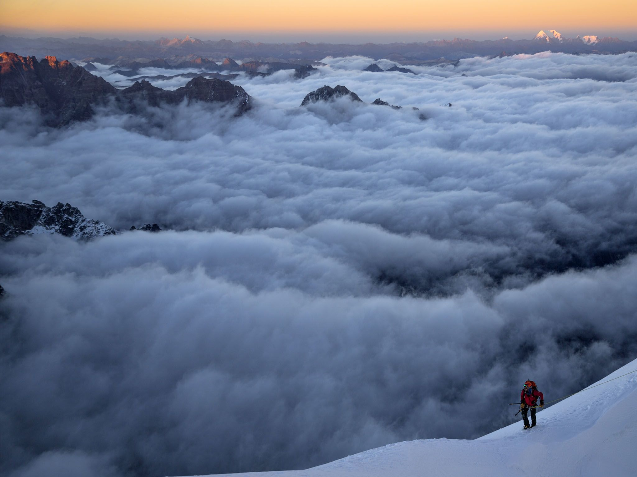 Kachin, Myanmar: Renan Ozturk climbing toward the summit of Hkakabo Razi way up over the clouds.... [Photo of the day - May 2016]