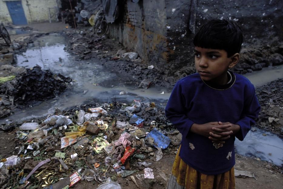 A child near trash pile. [Photo of the day - July, 2011]