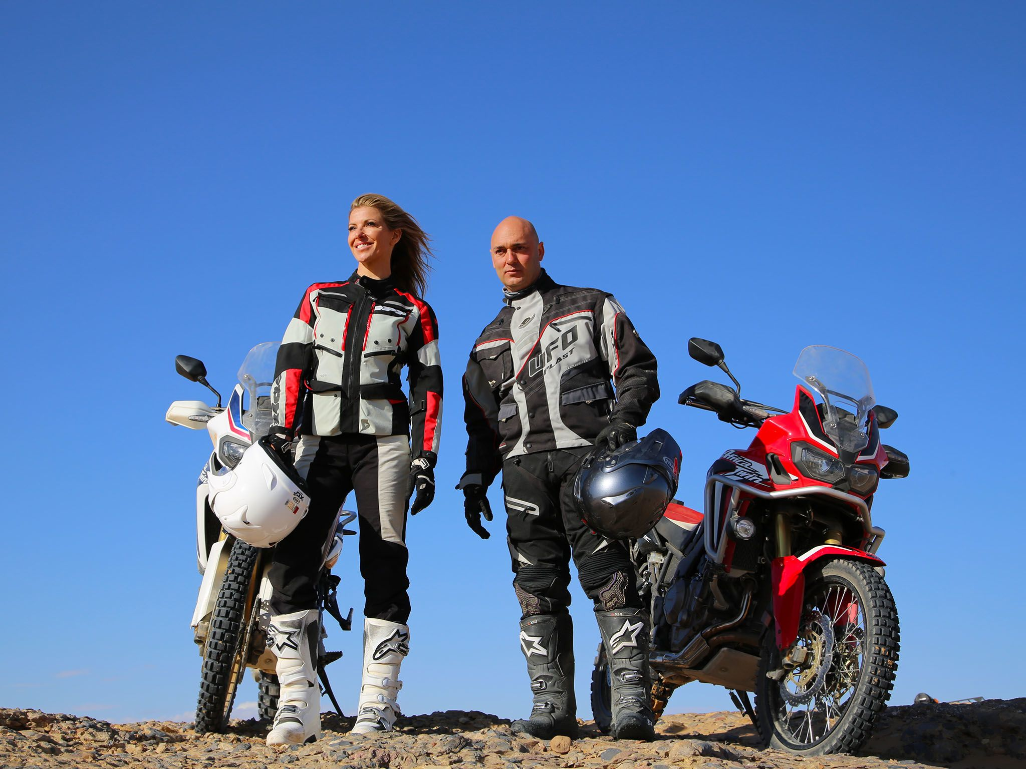 Erfoud, Morocco: Laura and Christophe standing next to their motorbikes with their helmets in... [Photo of the day - June 2016]