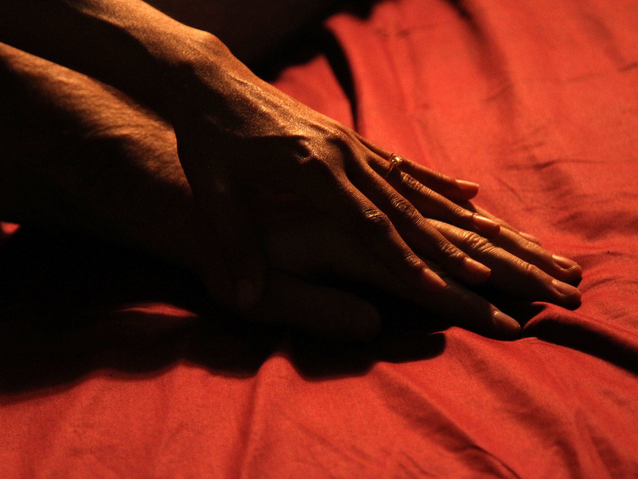 Los Angeles, Calif.: A couple's hands in bed together. This image is from Original Sin: Sex. [Photo of the day - September 2016]