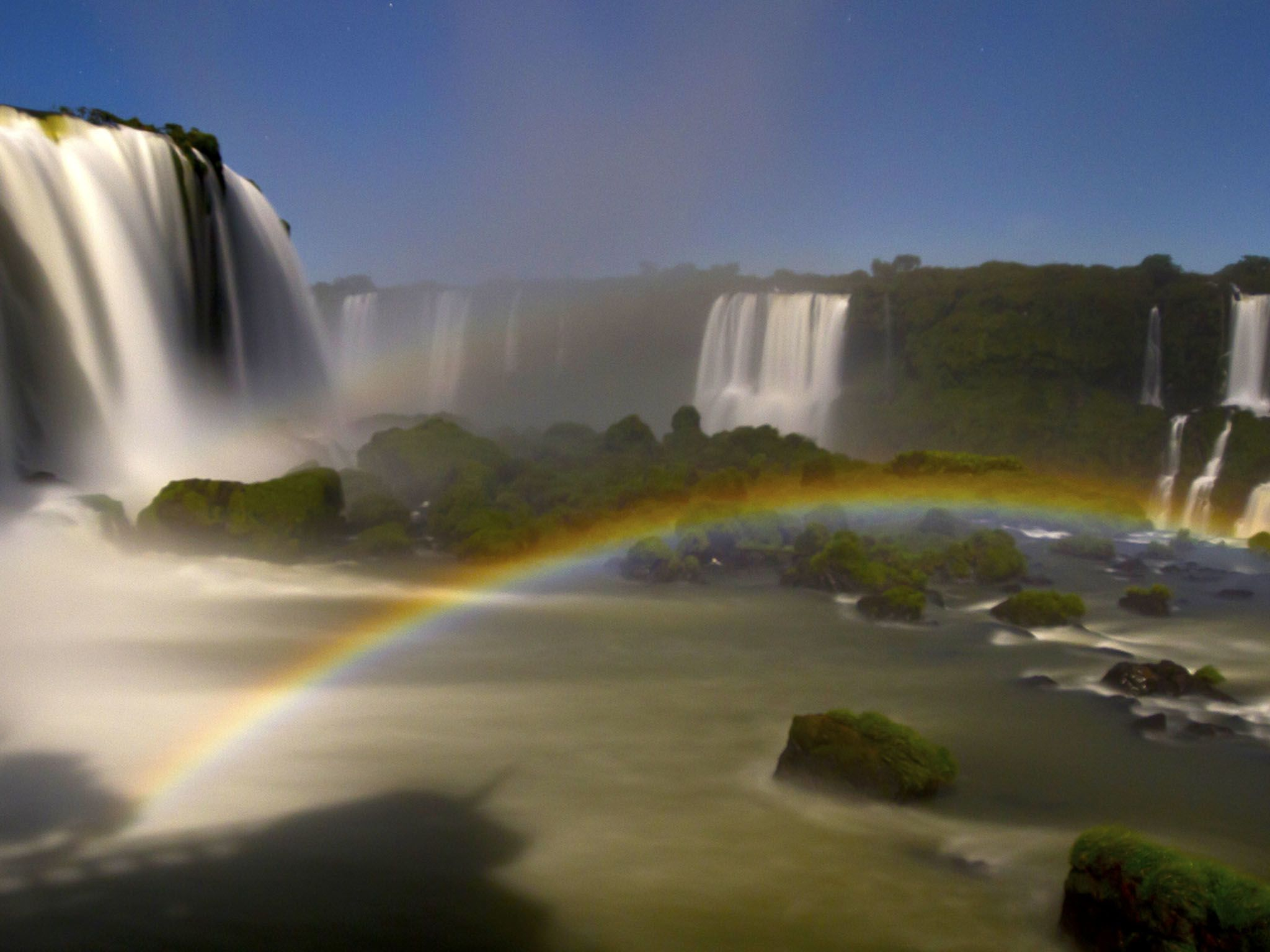 Iguazu Falls with rainbow in the mist. This image is from River in the Sky. [Photo of the day - دسامبر 2016]