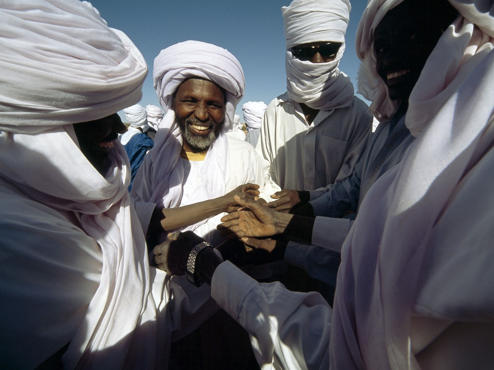 In the north of Chad, men congratulate each other after breaking the month-long Ramadan fast.... [Photo of the day - February 2017]