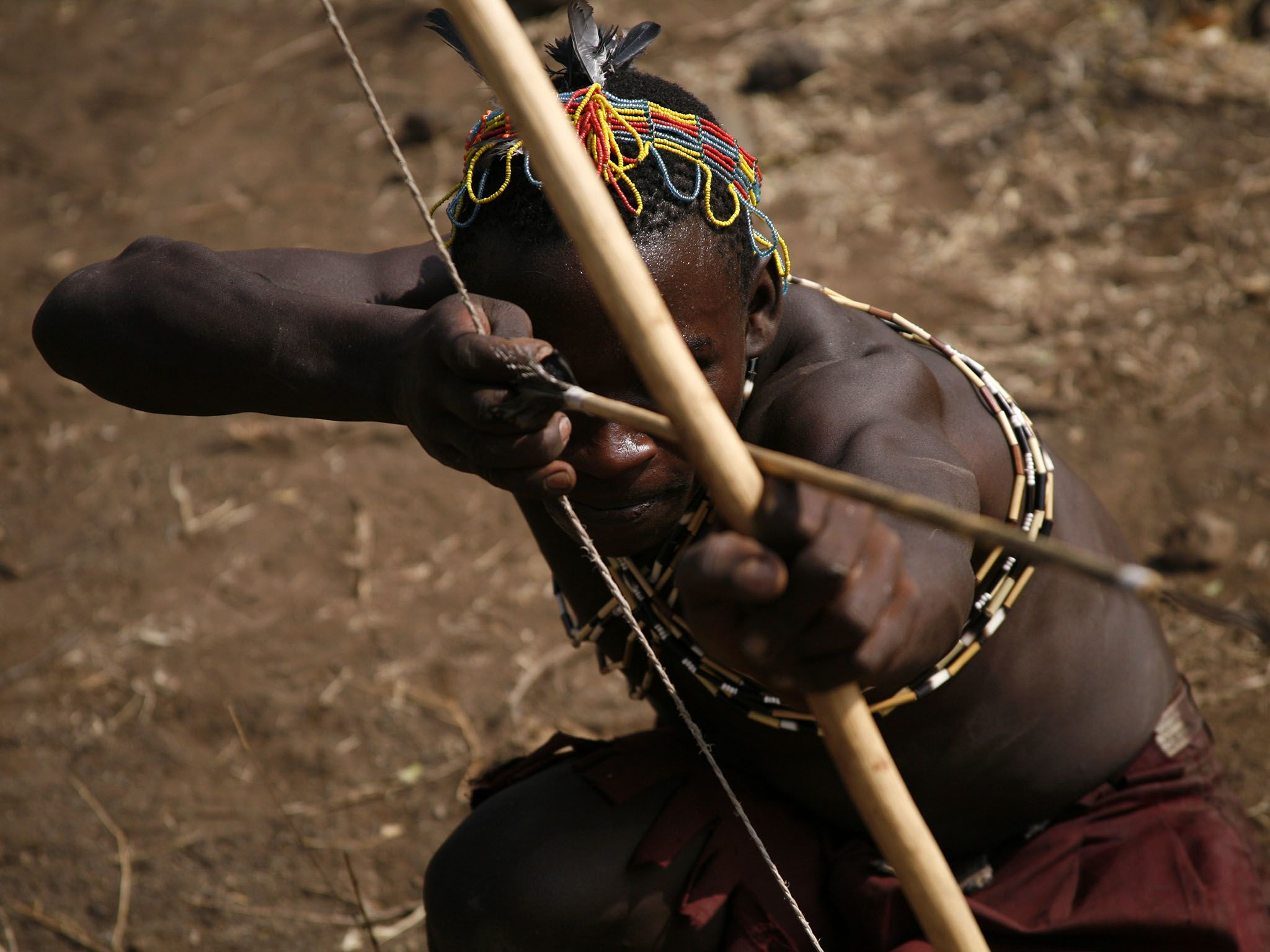 Lake Eyasi, Tanzania: Hadzabe man with bow and arrow.  The Hadzabe, who live about 15-hundred... [Photo of the day - March 2017]