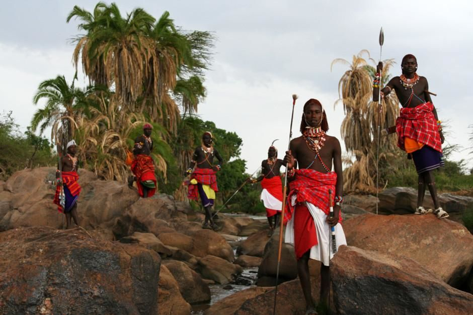 Maasai warriors stand tall with their spears. This image is from Warrior Road Trip. [Фото дня - Февраль 2012]