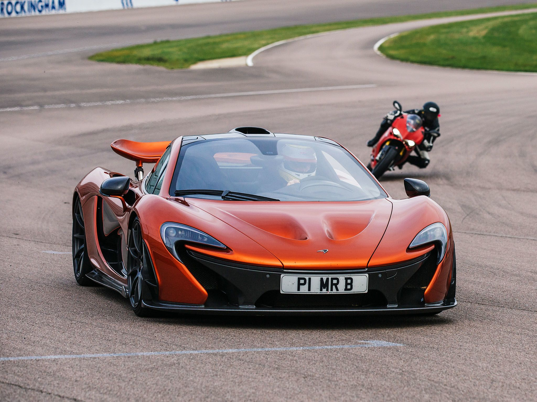 Leicester, UK: P1 and  Bike on the track at the Rockingham Motor Speedway. This image is from... [Photo of the day - May 2017]