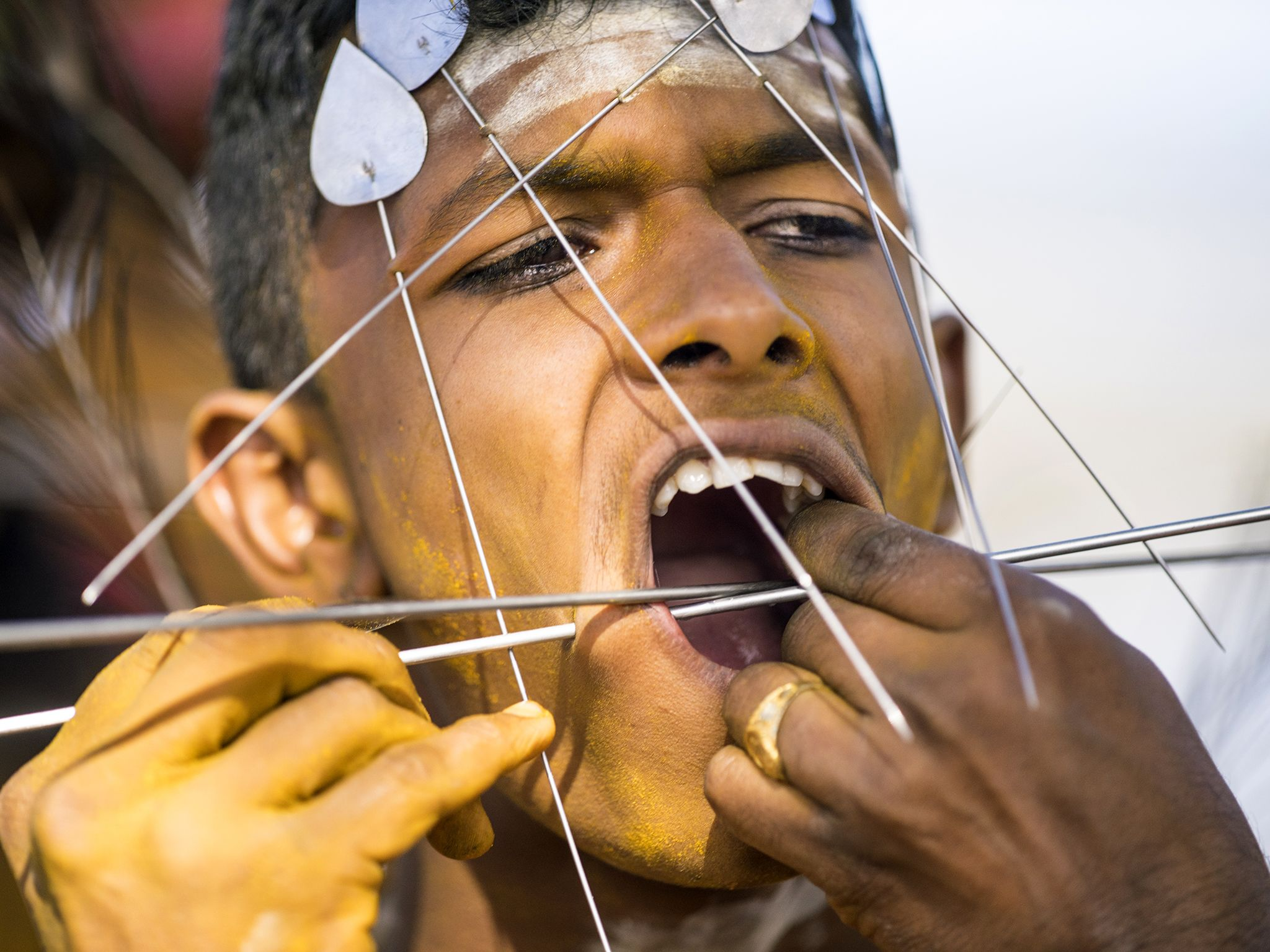 Suva, Fiji: Young devotee is pierced by priests as a sign of devotion, before making the walk... [Photo of the day - July 2017]