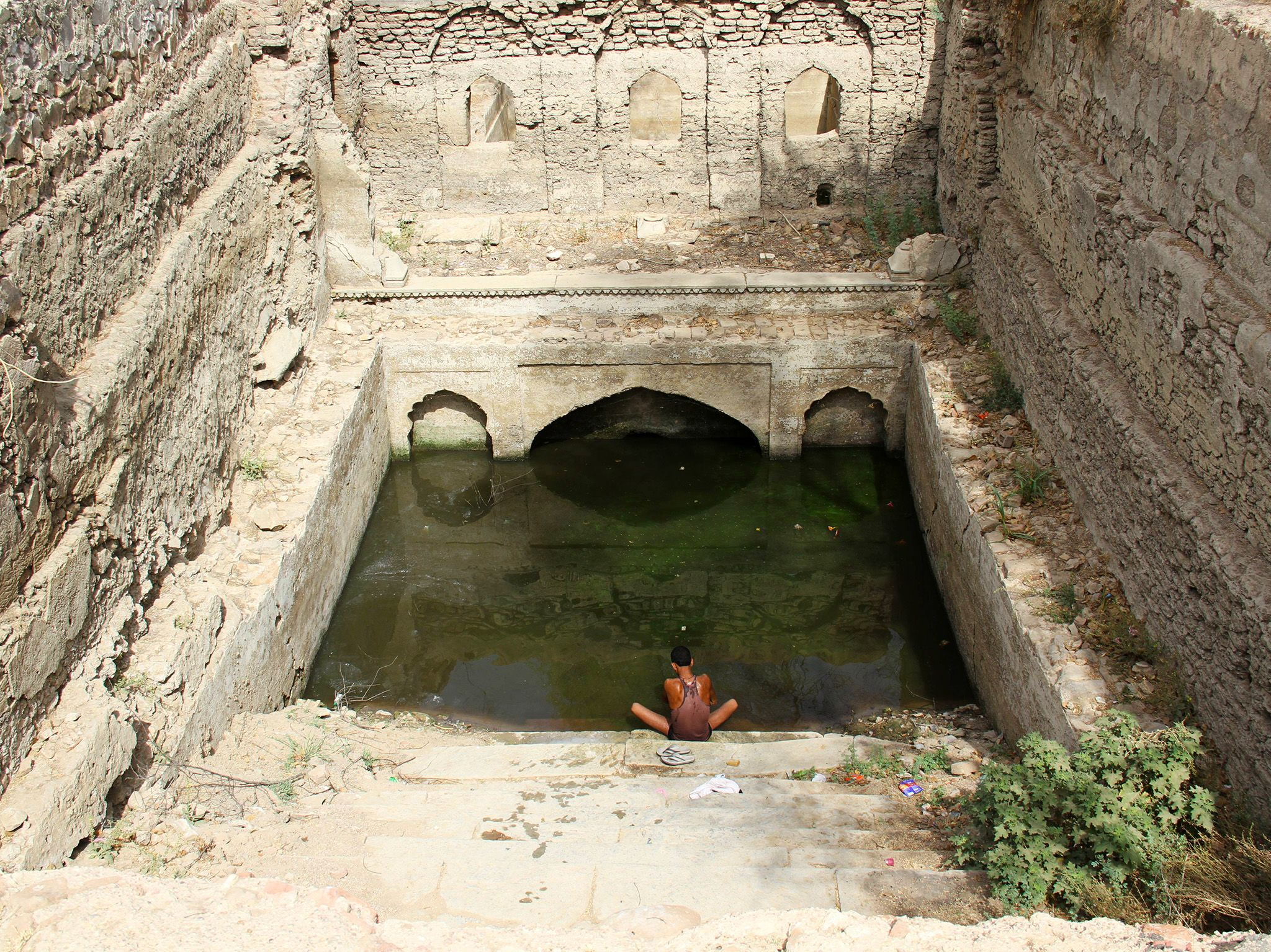 Jaipur, India: Man sitting on the banks of a step well in Jaipur, India. This image is from Parched. [Photo of the day - August 2017]