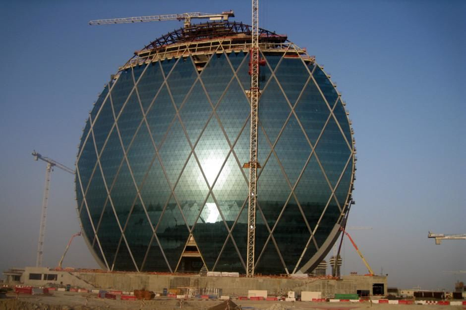 Abu Dhabi, United Arab Emirates: The Aldar headquarters building under construction with cranes... [Photo of the day - March 2012]