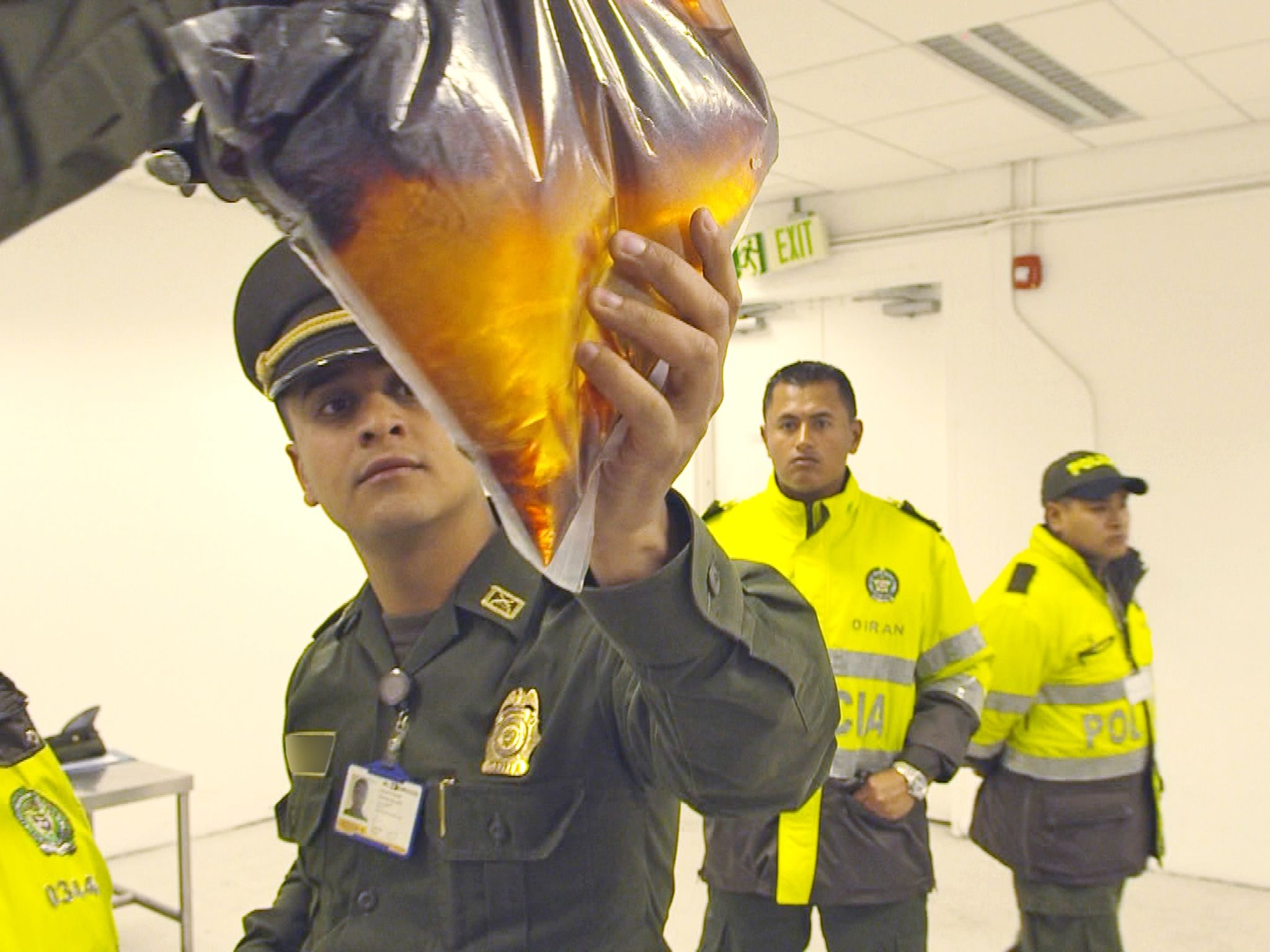 Bogota, Colombia:  An officer examines suspicious fluid. This image is from Airport Security:... [Photo of the day - October 2017]