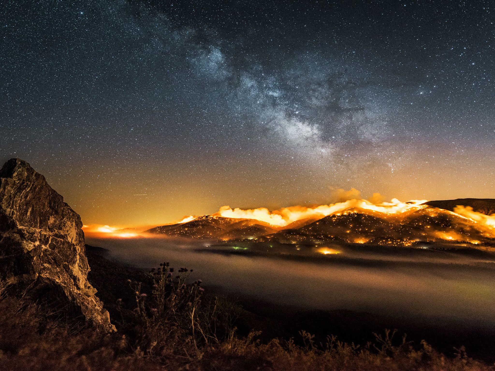 Time-lapse burning hillside with Milky way above.  This image is from One Strange Rock. [Photo of the day - March 2018]