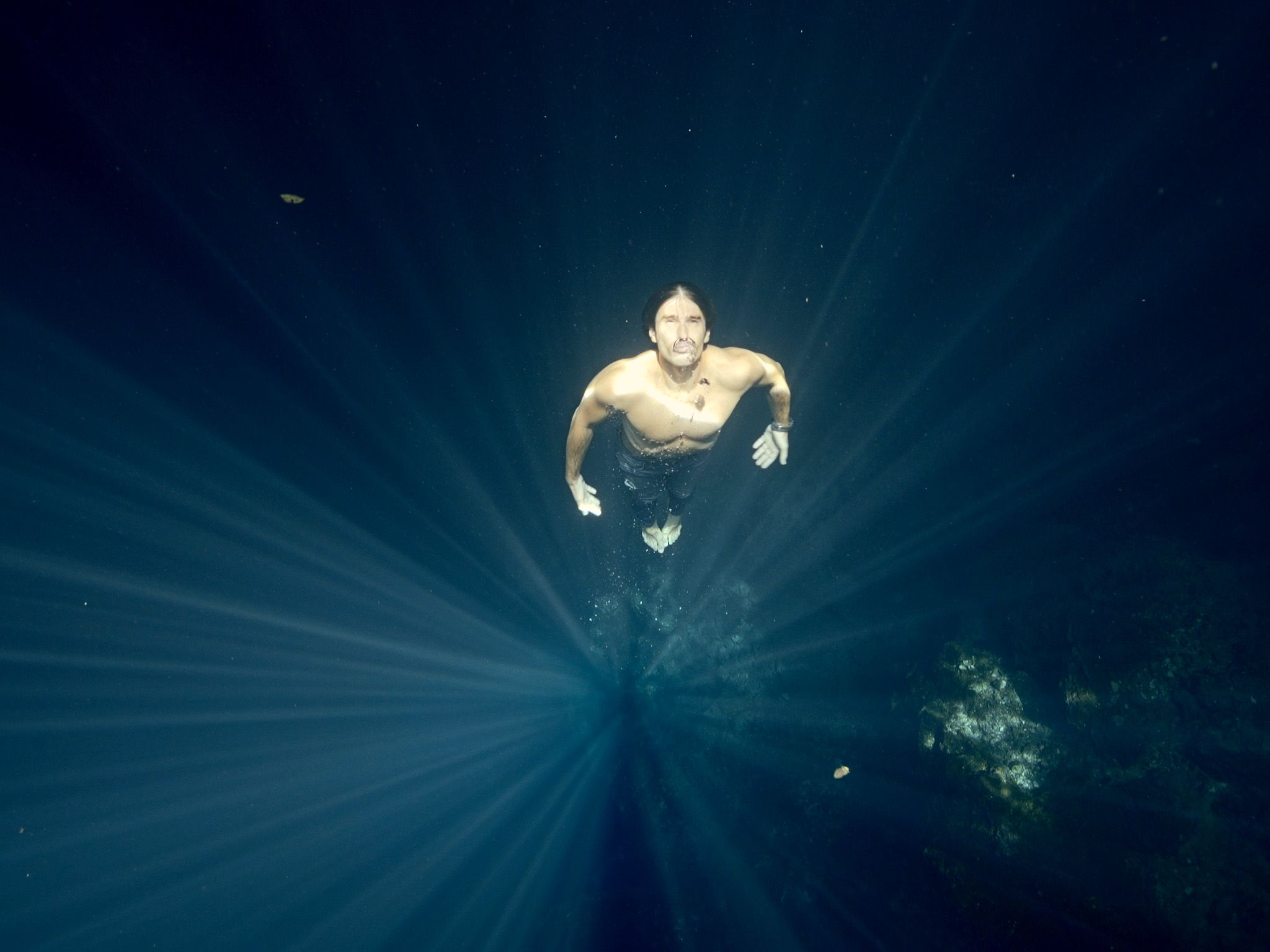 Free diver coming to the surface in a ray of sunshine.  This image is from One Strange Rock. [Photo of the day - March 2018]