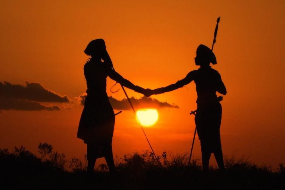 Laikipia, Kenya: Silhouette of Boni and Lemarti shaking hands at sunset. This image is from Warri... [Dagens foto - april 2012]