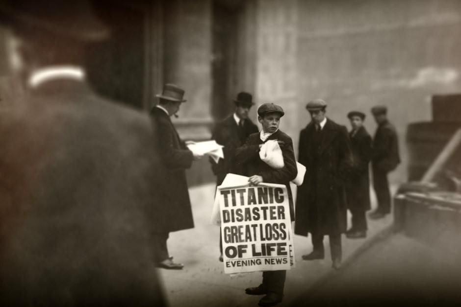 Young boy selling newspapers with &quot;Titanic Disaster&quot; news. 100 years ago today, the Titanic suffe... [Dagens billede - april 2012]