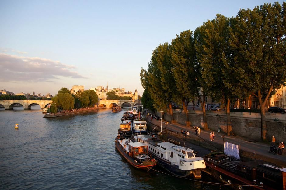 A wide shot facing east, during sunset on the Seine River in Paris, France. This image is from Mo... [  -  2012]