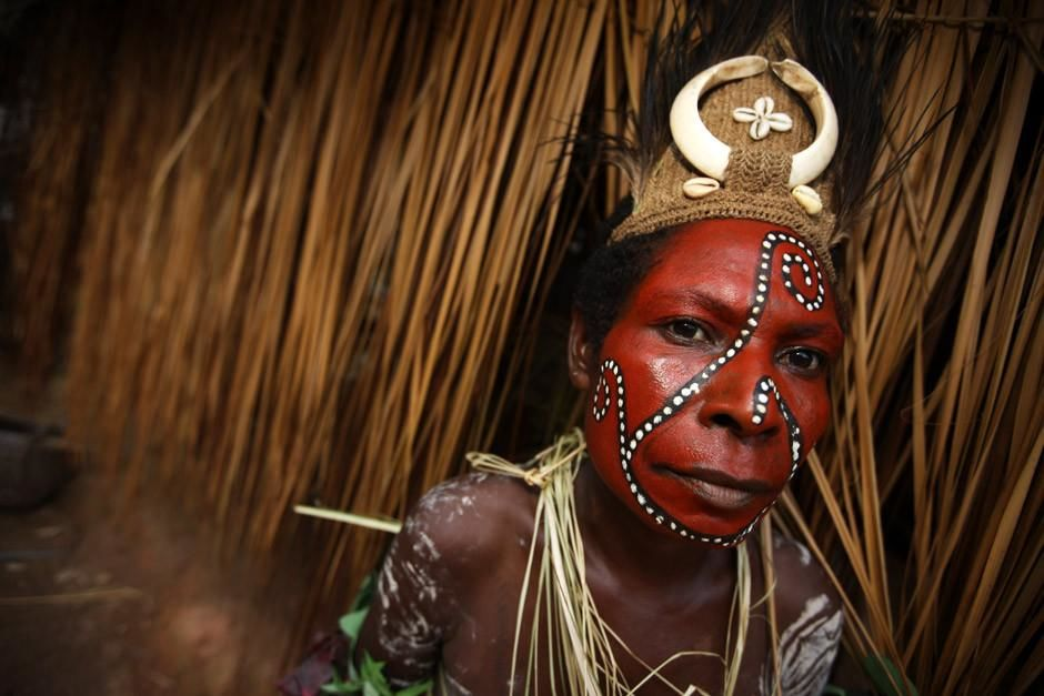 A Karim speaker from the Sepik River region of Papua New Guinea poses in traditional face paint.... [Dagens foto - april 2012]
