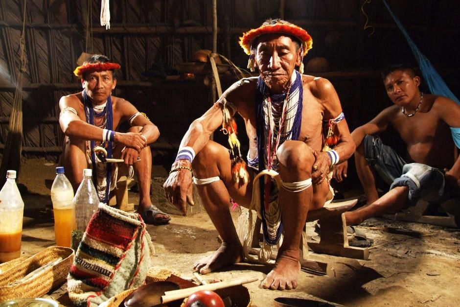 A chief and two men sit in a hut in Puerto Ayacucho, Venezuela.  This image is from Taboo. [Fotografija dana - travanj 2012]